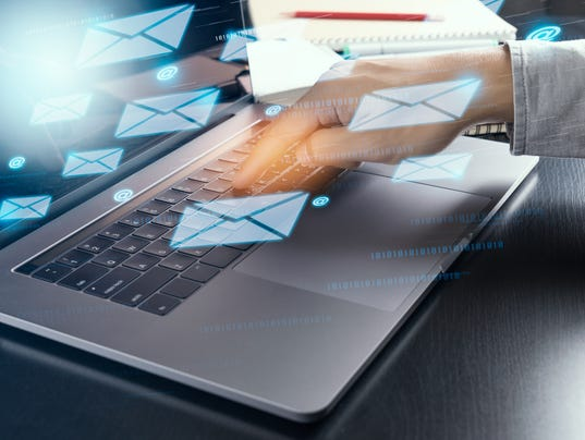 hand sending electric mail from modern laptop computer