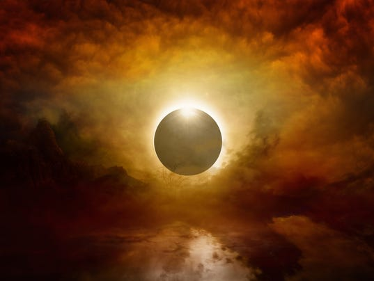 Full sun eclipse in dark red sky, end of world