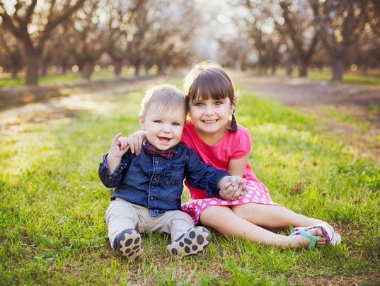 Two Happy Young Siblings are Bonding at the Almond Orchards