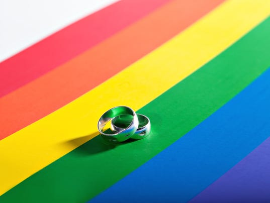 two rings on background of rainbow flag