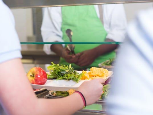 School students choosing variety of healthy foods in lunch line