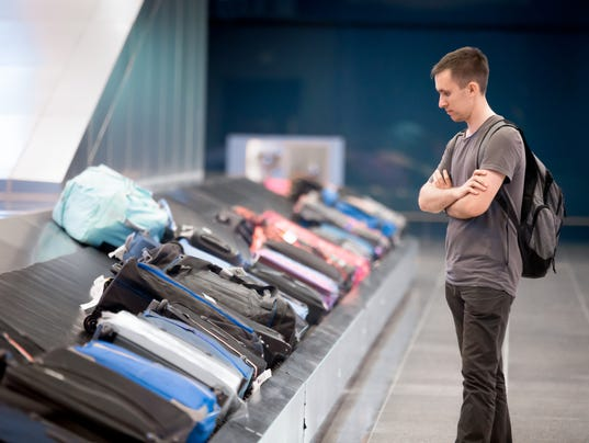 Young man waiting for baggage