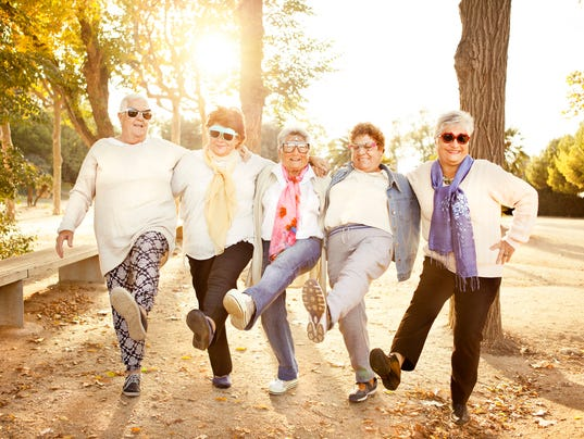 Happy senior adult women wearing sunglasses