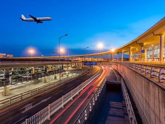 International Airport terminal T3 Beijing night with plane