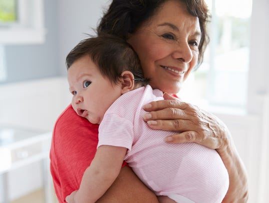 Proud Grandmother Holding Baby Granddaughter