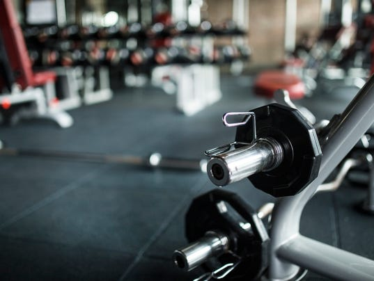 Heavy weights barbell in the fitness gym