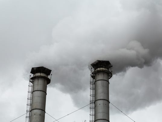 The smoke from the chimneys of the CHP. Pollution of the environment. Environmental disaster