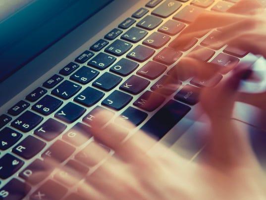 Typing on laptop closeup