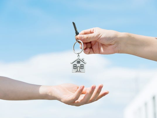 Handing over the house keys