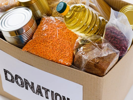 Food in donation cardboard box, isolated on white background