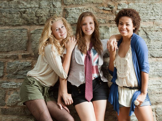 Young Women: Three Happy Smiling Teenage Girls by Stone Wall