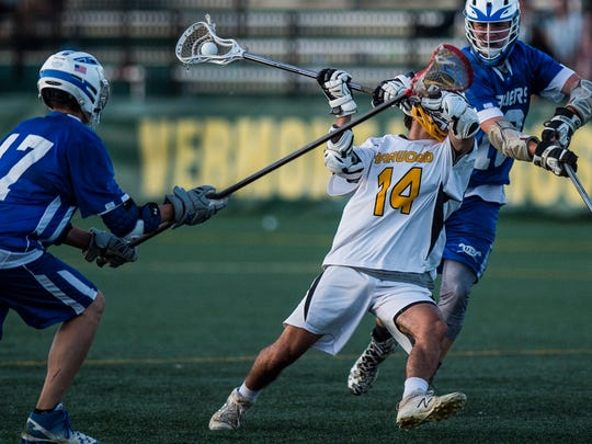 Harwood's Ely Kalkstein shoots during the 2018 Division II high school boys lacrosse state championship game at UVM.