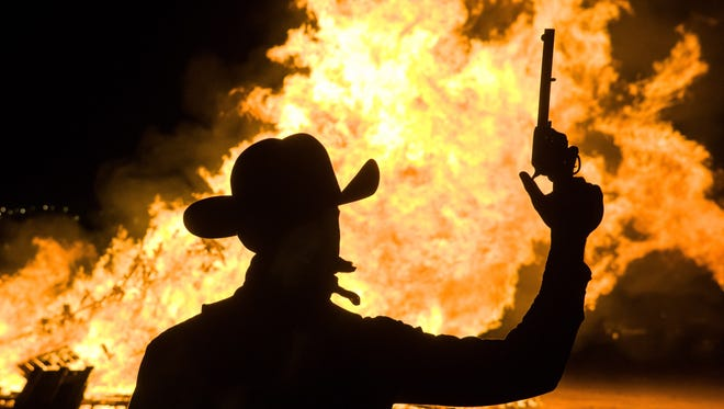 Pistol Pete is pictured in front of the New Mexico State University bonfire in 2015.