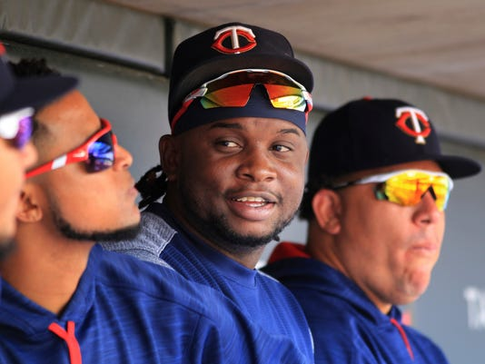 File-This Aug. 6, 2017, file photo shows Minnesota Twins third baseman Miguel Sano sitting in the dugout against the Texas Rangers in the sixth inning during a baseball game on  in Minneapolis.  A photographer is accusing  Sano of grabbing her wrist and trying to kiss her and pull her through a door after a 2015 autograph session. Betsy Bissen accused Sano on Thursday, Dec. 28, 2017, in a tweet, saying what he did amounted to assault. (AP Photo/Andy Clayton-King, File)