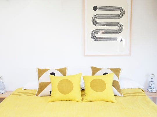 Block Shop Textiles's Marfa Kantha quilt, paired with Marigold and Signal pillows