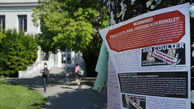 """A leaflet is seen stapled to a message board near Sproul Hall on the University of California at Berkeley on Friday, April 21, 2017. The campus is bracing for a showdown when the conservative provocateur Ann Coulter has vowed to speak in defiance of the university's wishes. Officials, police and the campus Republicans who invited Coulter, say there are valid concerns for violence in what is being called an ongoing """"Battle of Berkeley."""""""