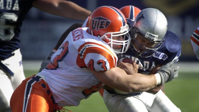 UTEP's Trey Merkens buts heads with the Nevada's Jesse Twist during their game in 2000.