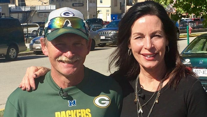 Marybeth Mielke, right, helped save the life of Chuck Wickert, left, when he had a heart attack at Lambeau Field on Sept. 17, 2000. It took Wickert 17 years to meet Mielke.
