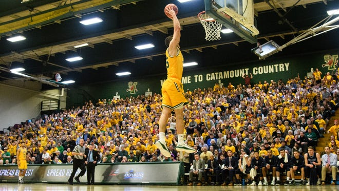 Vemront's Payton Henson goes up for a dunk Saturday night's America East men's basketball quarterfinal game vs. Maine.