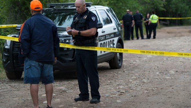 Police work the scene after one deceased person's body was pulled from the Cache La Poudre river on Sunday, June 24, 2018, at Legacy Park in Fort Collins, Colo.