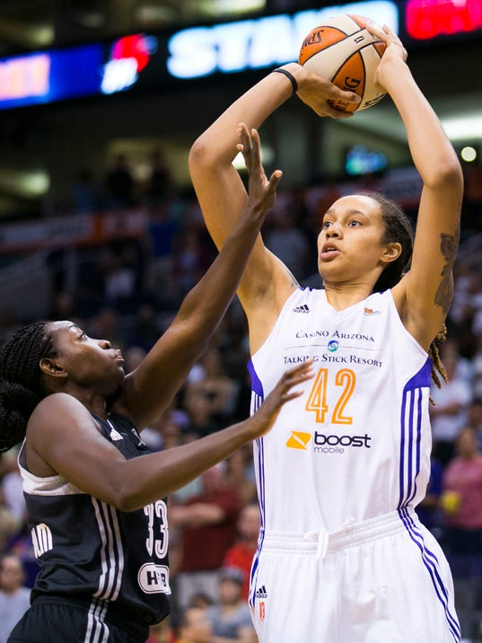 Phoenix Mercury center Brittney Griner eyes the basket as San Antonio Stars forward Sophia Young-Malcolm defends during the first half of a WNBA basketball game at the US Airways Center in Phoenix on Friday, May 23, 2014. (AP Photo/The Arizona Republic, David Wallace) MESA OUT  MARICOPA COUNTY OUT  MAGS OUT  NO SALES