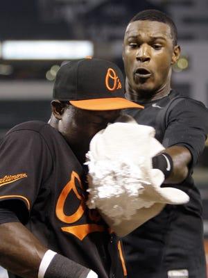 The Baltimore Orioles' Adam Jones, right, delivers a shaving cream pie to a teammate.