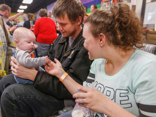 Rebecca Shields and Brandon Johnson play with 5-month-old