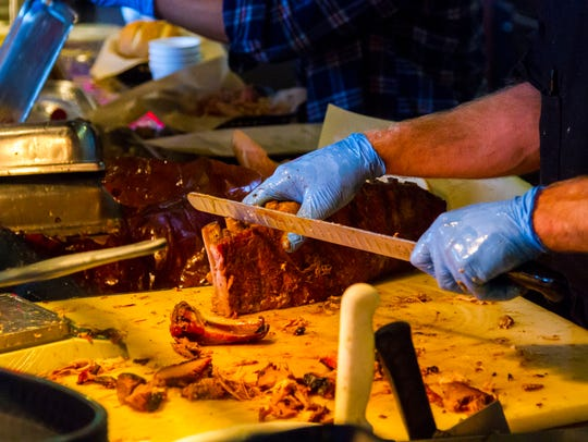 Cooks prepare orders at Charlie's Southern Barbecue,