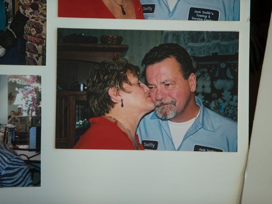 "Lorraine Talarico-Smith kisses her late husband Thomas ""Smitty"" Smith in an old photo kept by Talarico-Smith."