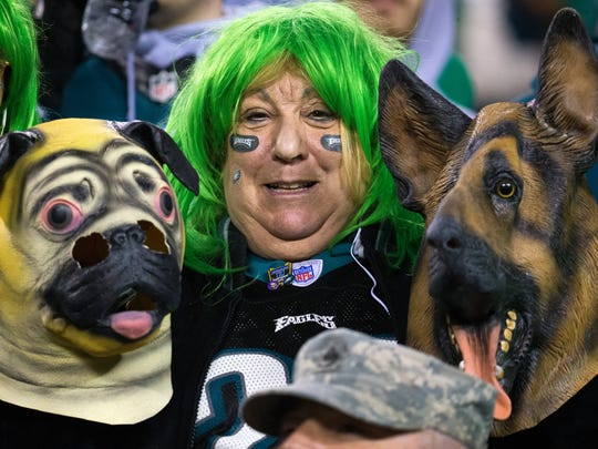 An Eagles fan holds her underdog masks Sunday at Lincoln Financial Field.