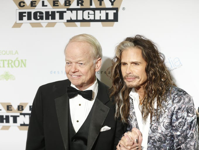 Jimmy Walker and Steven Tyler pose for pictures during