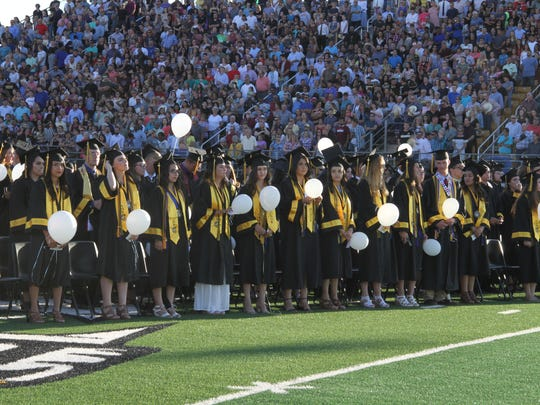 Alamogordo High School Class of 2018 stand prior to receiving their diplomas Friday evening.