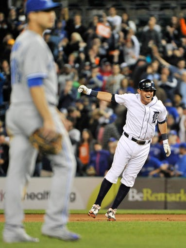 Tigers' Ian Kinsler celebrates after his wallkoff single