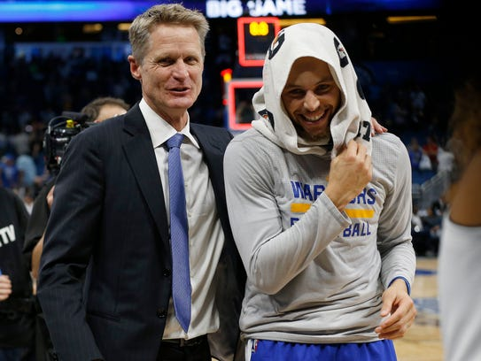 Steve Kerr laughs with Stephen Curry after beating