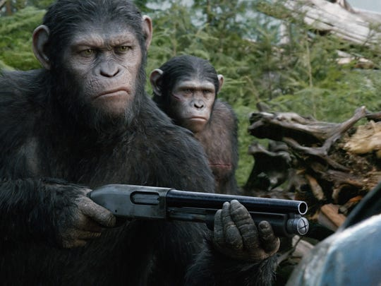 """Caesar (front, Andy Serkis) in a scene from """"Dawn of"""
