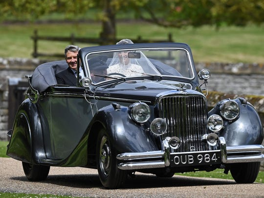 Pippa Middleton arrives with her father Michael Middleton