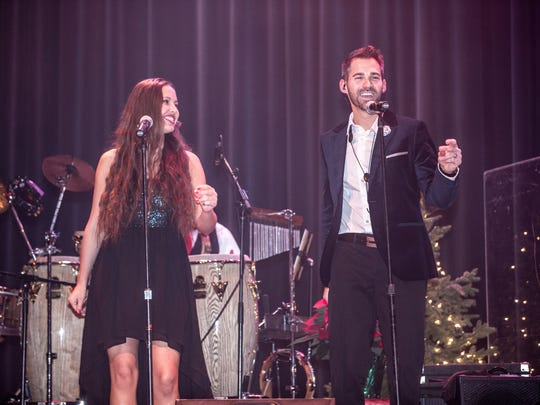Rebecca Brunner, left, performs with Phil Denny at the 2014Phil Denny and Friends Christmas Collective concert.