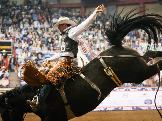 Brody Cress rides a bronc during the Cinch Chute-Out