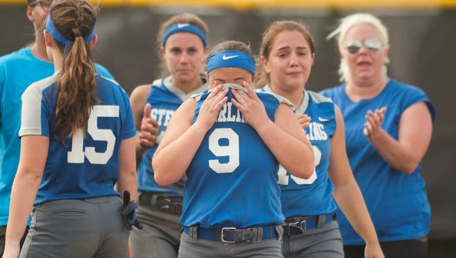 Members of the Sterilng High School softball team exit the field after Sterling's 9-4 loss to Robbinsville in the softball Group 2 state semifinal game played at Rowan University on Thursday, May 31, 2018.