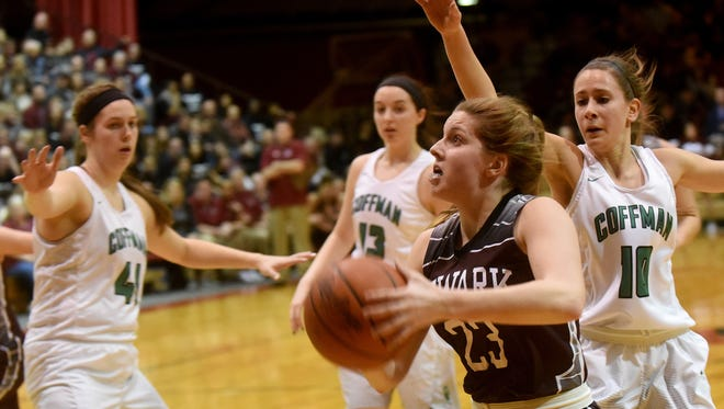 Newark sophomore Morgan Sharps breaks past Dublin Coffman defenders Paige Warren, Abby Vollmer and Dana Axner to shoot for two during the Wildcats' 66-54 victory against the Shamrocks in the Division I regional final on this past Friday.