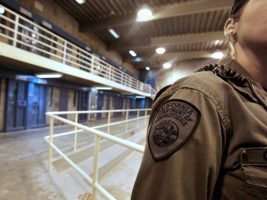 A correctional officer is seen in one of the housing