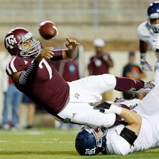 Texas A&M Aggies quarterback Kenny Hill (7) throws the ball to avoid a sack by Rice Owls  defensive end Dylan Klare during the first quarter at Kyle Field in College Station on September 13, 2014.
