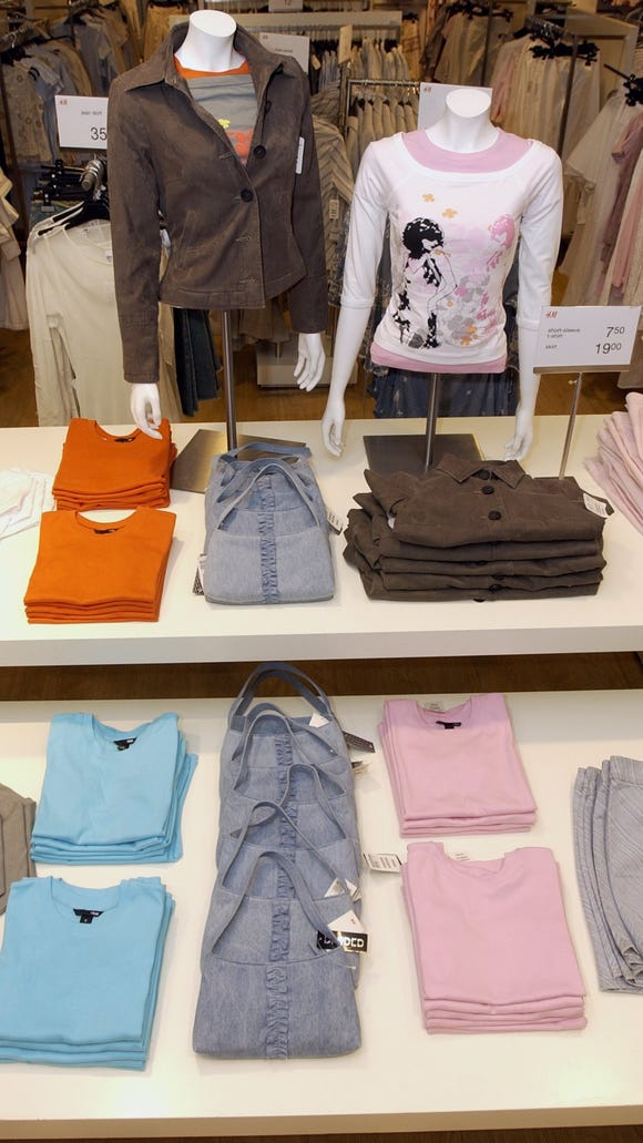 Purses, and colorful shirts make up a display of the H&M Spring collection at the H&M in the Cherry Hill Mall in 2013. The store just unveiled its new look after four months of renovations.