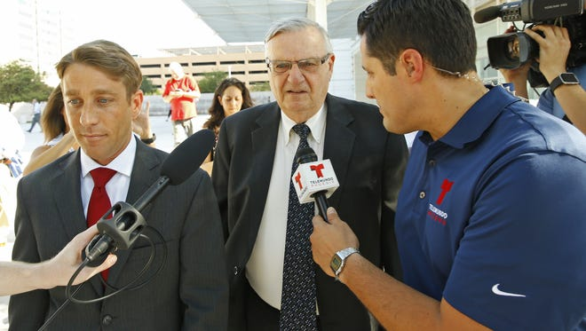 Former Maricopa County Sheriff Joe Arpaio and his attorneys emerged from the federal courthouse following the first day of his criminal contempt trial on June 26, 2017, in Phoenix.