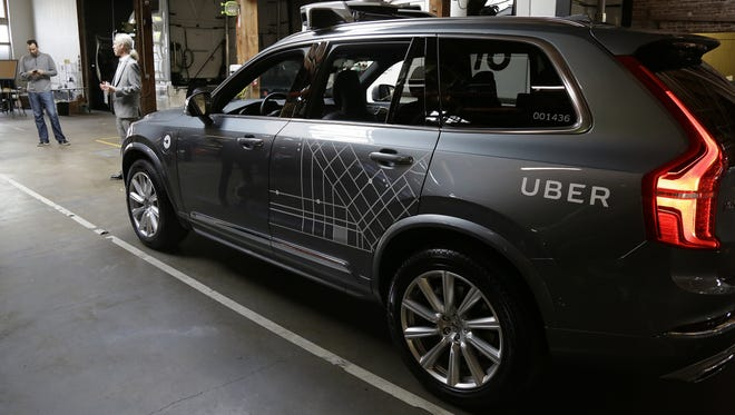 An Uber driverless car is displayed in a garage in San Francisco. Uber suspended all of its self-driving testing March 19 after what is believed to be the first fatal pedestrian crash involving the vehicles.