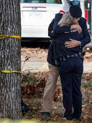 FILE- In this Nov. 22, 2016, photo, dducator Franklin McCallie, background, hugs Chattanooga Police Assistant Chief Danna Vaughn near the scene of a school bus crash in Chattanooga, Tenn. Students and administrators raised concerns about a Tennessee school bus driver's behavior behind the wheel in the weeks before a crash that killed several children. Records released by the school district Friday, Nov. 25, include two written statements by students complaining about Johnthony Walker's driving.