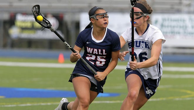 Wall's Alexa Sirchio runs the ball around Middletown South's Brielle Bezick during the Wall and Middletown South girls lacrosse game at Middletown South High School Middletown, NJ Thursday April 13, 2017.   Tanya Breen