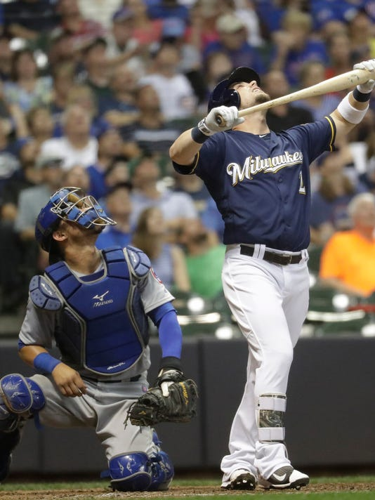 Milwaukee Brewers' Scooter Gennett reacts as he pops up to end the seventh inning of a baseball game against the Chicago Cubs Wednesday, Sept. 7, 2016, in Milwaukee. (AP Photo/Morry Gash)