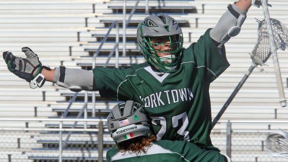 Yorktown's Dom Cioffi (26) celebrates with his teammate Hunter Embry (23) their 7-6 win over Shoreham- Wading River during boys lacrosse state semifinals at Hofstra University Shuart Stadium in Hempstead June 8, 2016.