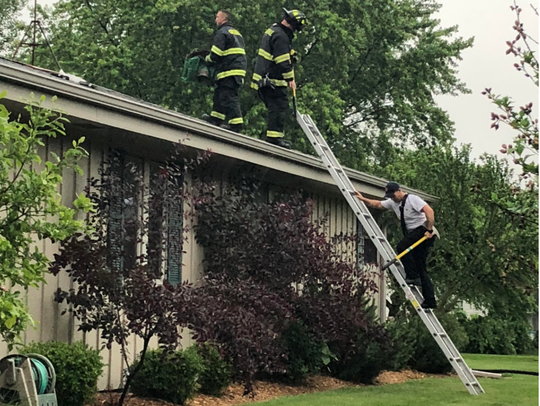 Greendale firefighters check the roof of the home at